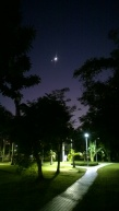 Moon and Venus, seen from open ground in Da-An Forest Park during night.